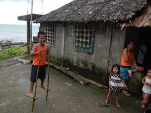 Kid on bamboo stilts in Castilla