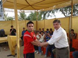 Javed Getting the award of emerging player