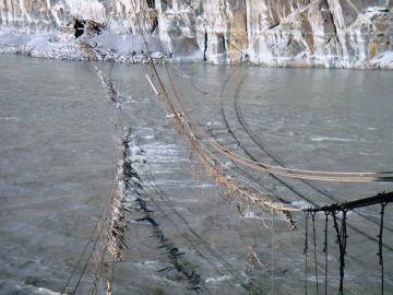 The damaged suspension bridge in Hussaini