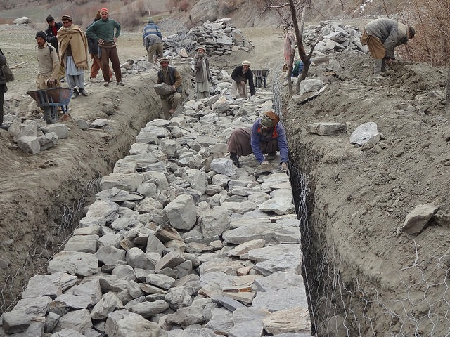 Labourers construct flood-control gabion walls – structures constructed by filling large galvanized steel baskets with rock – in northern Pakistan's remote Bindo Gol valley. Credit: Saleem Shaikh/IPS