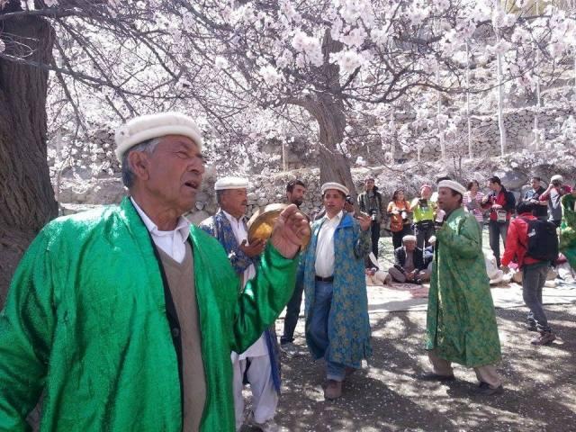 Elders rejoice under the flower laden trees, celebrating spring. Photo: MountainTV.NET