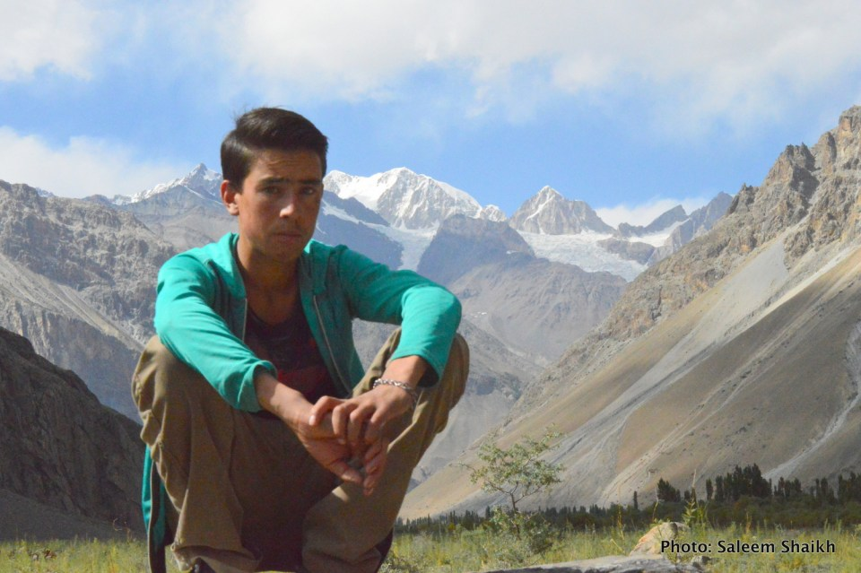 A young boy sits over a big boulder past overlooking Karakoram glaciers in scenic Darkut valley, some 103 miles from Gilgit –capital of Gilgit-Baltistan region. His account paints another grim picture. The devastating flood in 2010 devastating large-scale farm fields and homes, forcing over 100 families to migrat to nearby Ghakuch and Gilgit towns in search of livelihoods. Photo credit: Saleem Shaikh