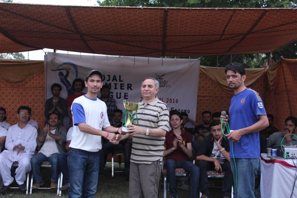 Captain Sher Zaman receiving the winning trophy from Mr. Gul Baig