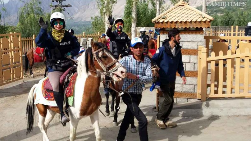 Hunza: Chinese tourists travel on horses from Sost to Karimabad to promote tourism