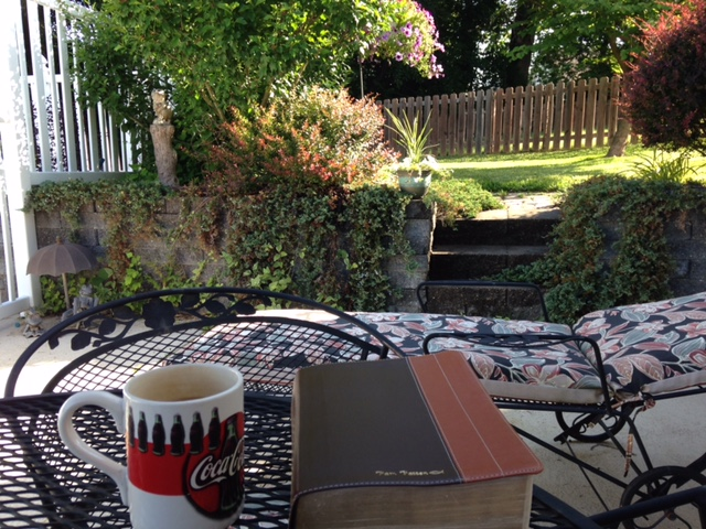 bible and coffee on outside patio
