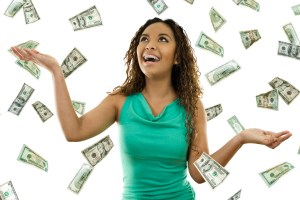 woman standing with open arms amidst falling money