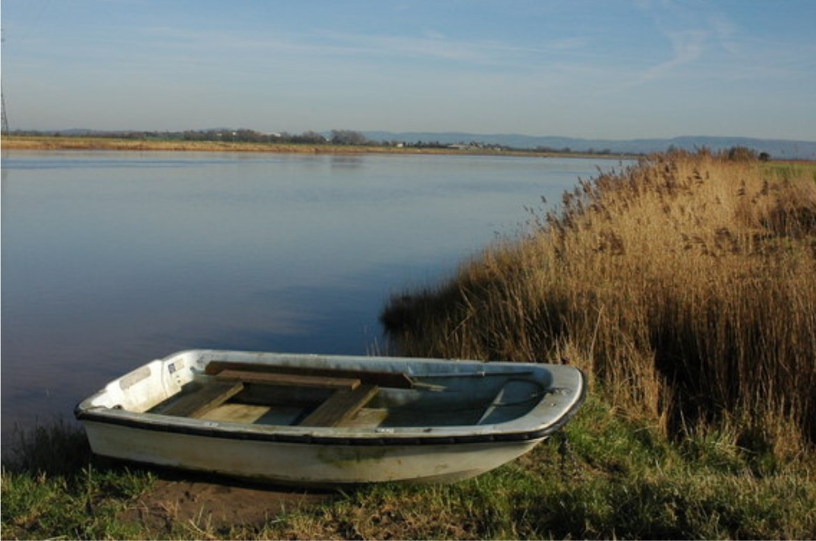 small boat on the banks of the lake
