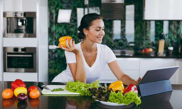 bigstock-Young-Woman-Looking-At-Recipe--207702631