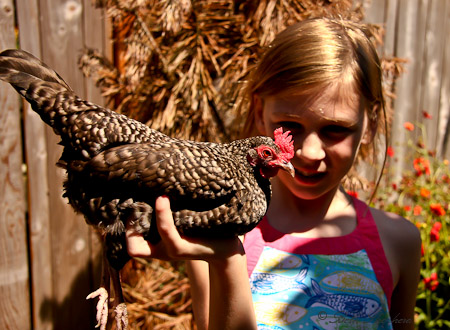 A girl and her hen