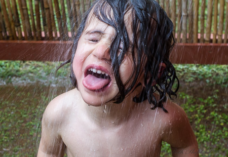 Tongue out in the Kauai outdoor shower