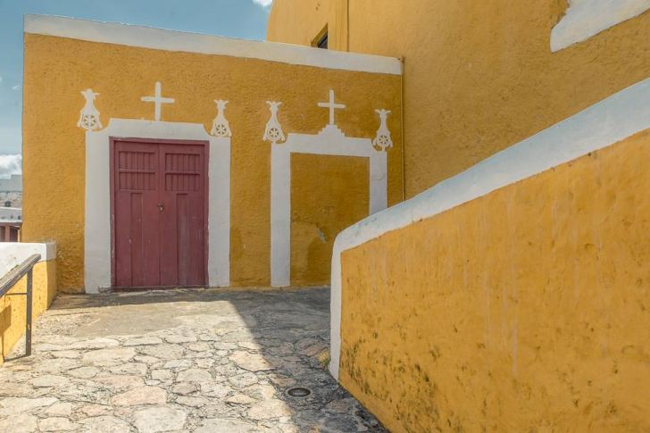 Side entrance to the historic church and convent in Izamal. Also painted Yellow.