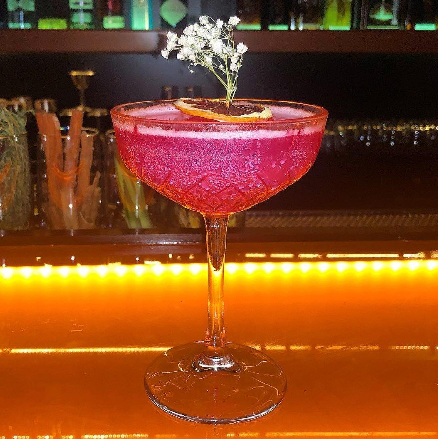 This cocktail uses saril-infused liquor (Jamaican flower)