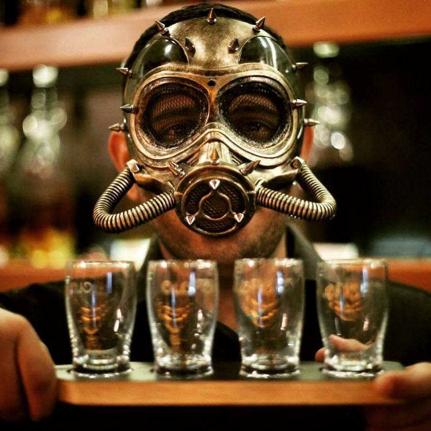 Can you imagine your waiter pouring you a drink dressed like this?
