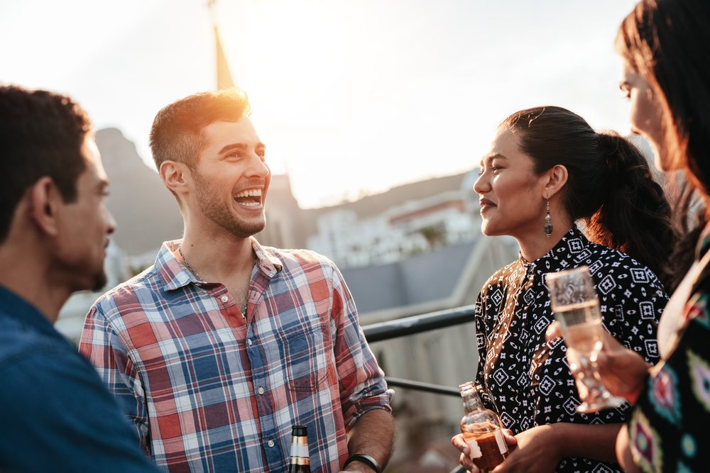 People at Gatto Blanco Rooftop Bar in Casco Viejo Panama during sunset