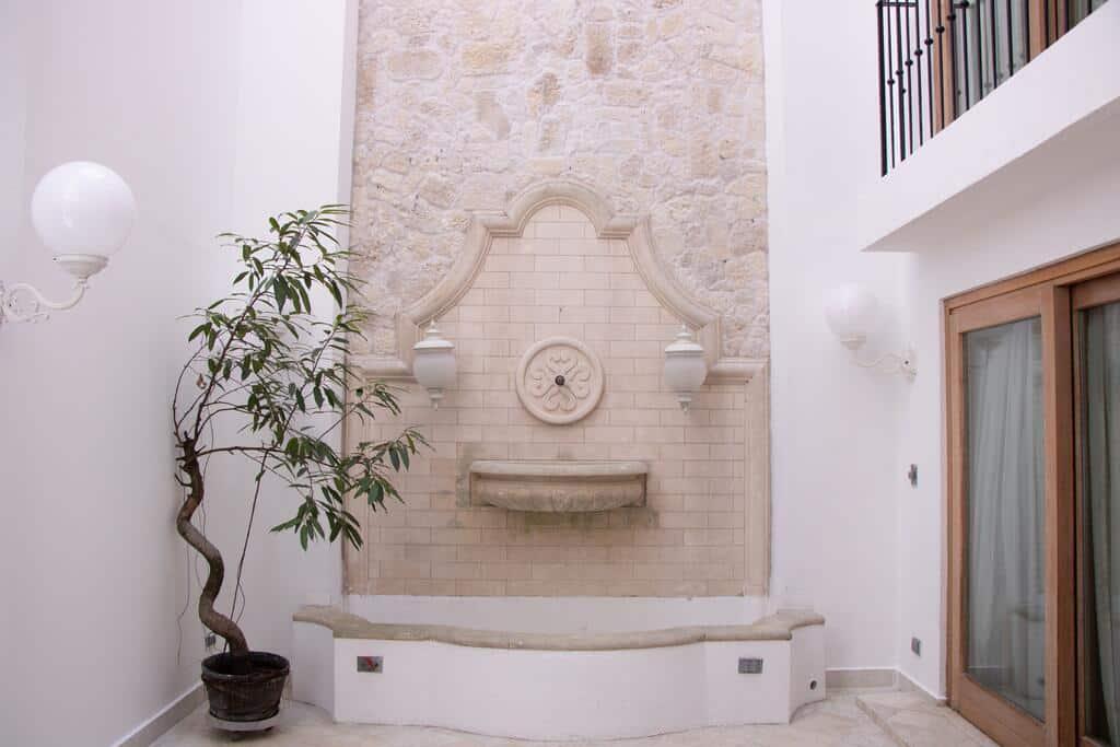 Villa Palma Boutique Hotel has an interior patio with a fountain