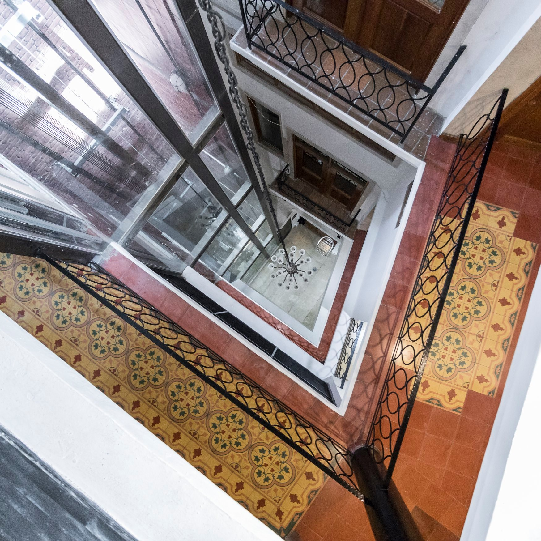 view down to the internal courtyard of Casa Antigua Hotel and elevator