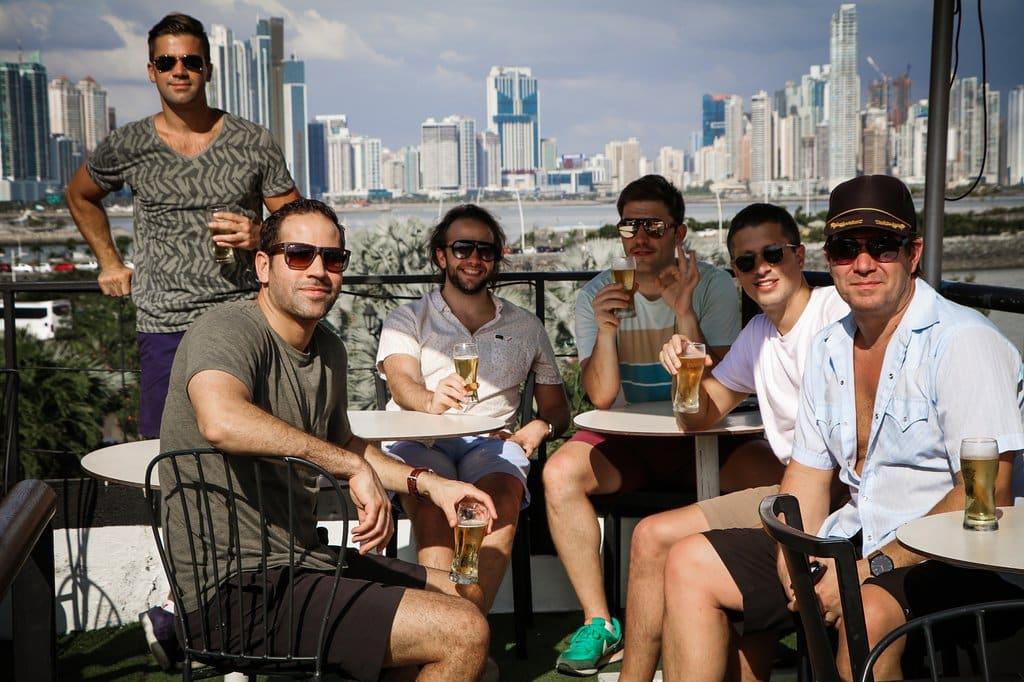 Men enjoying beer at Lazotea Restaurant and Rooftop