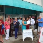 Chamber ambassadors gather to celebrate the grand opening of Gift Basket Designs.