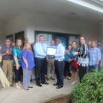 Chamber Ambassadors gather to celebrate the grand opening of Payday Inc.