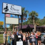 Chamber ambassadors gather to celebrate the grand opening of the Panama City Rescue Mission's Encore Boutique & More.