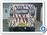 Zebra print car graphics on outdoor vehicle