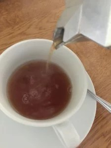 pouring tea from an espresso pot