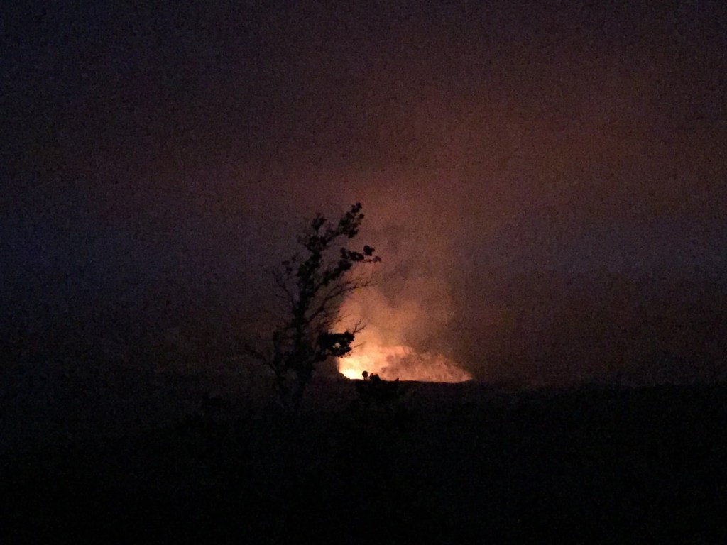 volcano at night with tree in front