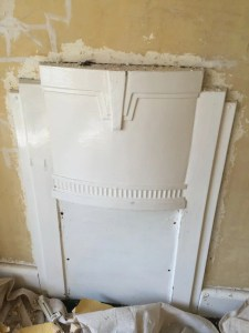 boarded-up Art Deco fireplace