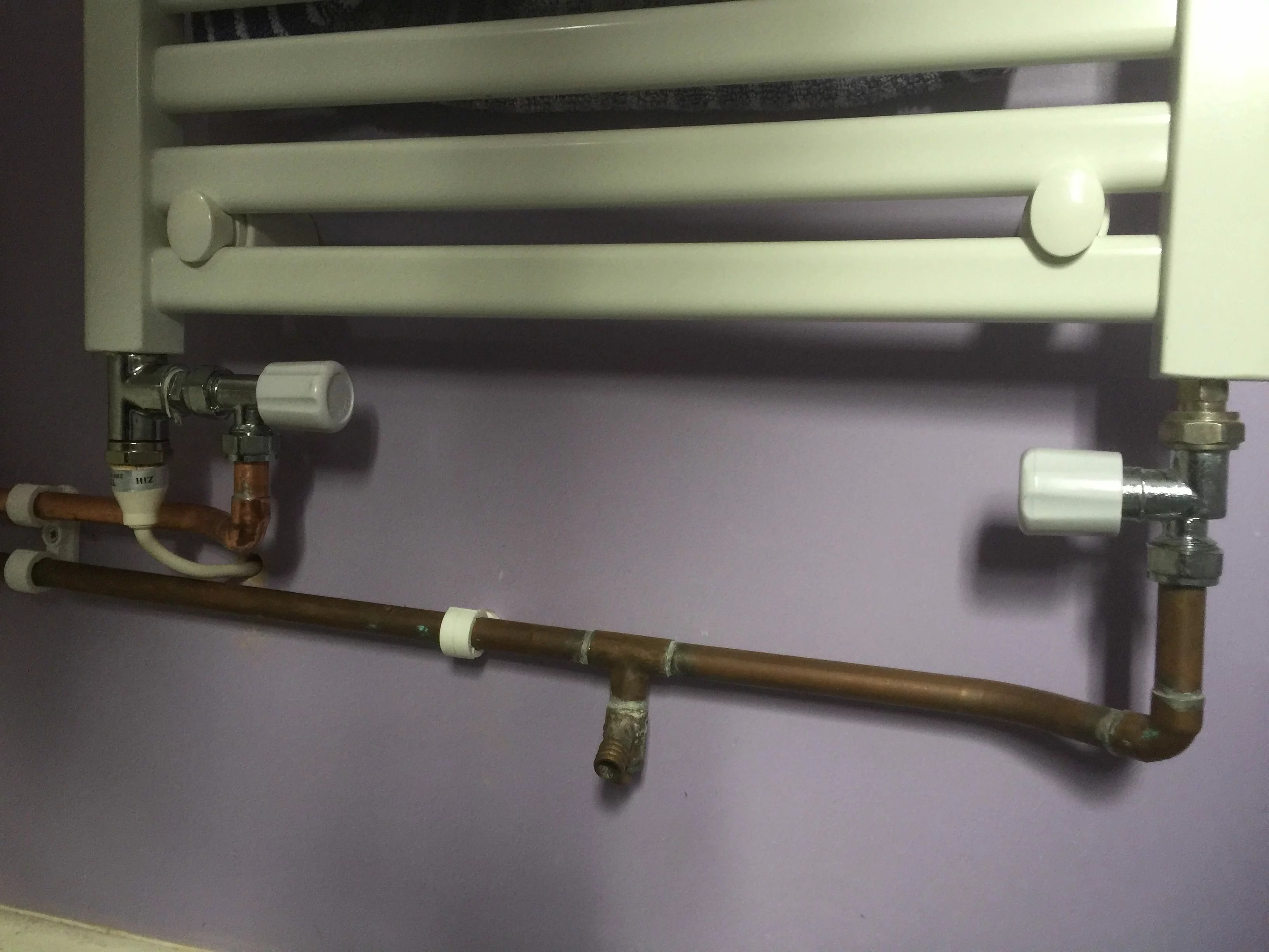 electric element at the bottom of a towel rail