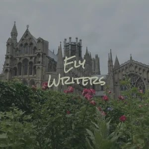 "Ely Cathedral in the background; pinky-red flowers in the foreground; text: ""Ely Writers"""