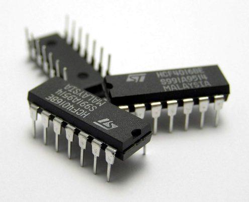 Three_IC_circuit_chips-Public-Domain