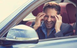 Stressed young man driver sitting inside his car