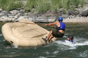 flipping rafts during white water rafting guide training