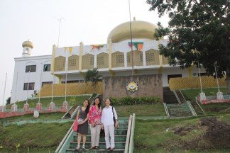 The Provincial Hall of Tawi-Tawi province stands behind ADC officers from left: Nannette Matilac, Mariel Francisco and Ligaya Amilbangsa during their Sept 2012 trip to Bongao.