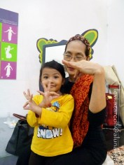 Hannah practices finger movements coached by Teacher Ligaya.