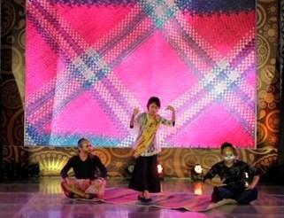 Mannex Siapno and Jimo Angeles with masks. Joy Ricote-Cruz as solo dancer.