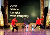 Glenn Llamador and Sol Lumba hit the tires and make percussive sounds while demonstrating the training regimen in arnis.