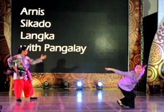 Ruby Varona demonstrates Sikado while Nannette Matilac performs Langka Budjang with a fan--an original choreography by Ligaya Amilbangsa.
