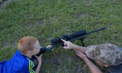 Sam showing Jake how to use the scope level