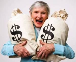 Smiling woman with money bags