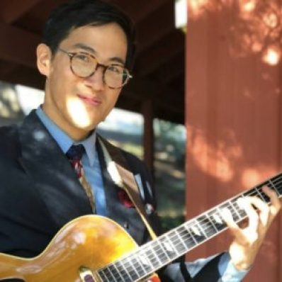 Vic Wong outdoors with archtop