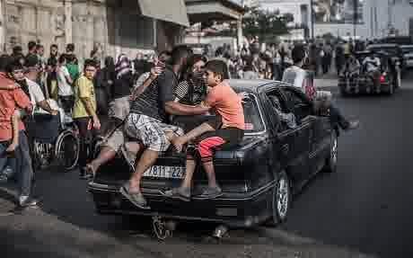 Warga Gaza Mengungsi pada hari Ahad 20-7-2014