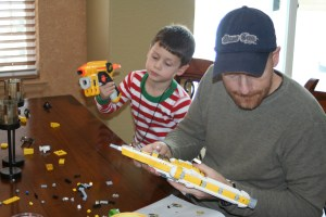 This is LegoMan and LegoSon, putting together the second Lego creation of Christmas morning.