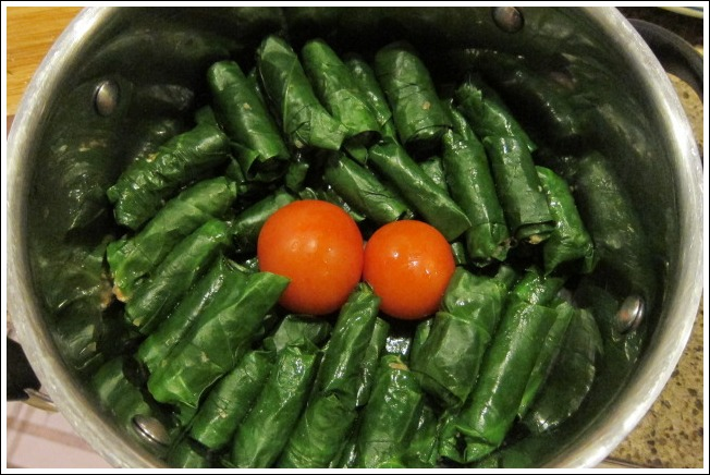 The sarma are neatly lined up round the pan ready to be cooked