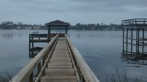 The dock leading up from the dining room and back yard