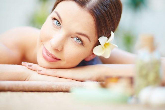 Serene girl relaxing in spa salon