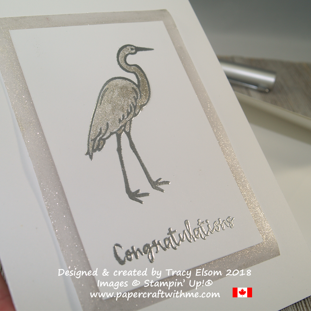 Close up of silver embossed stork on baby congratulations card with shimmer from Clear Wink of Stella Glitter Brush.