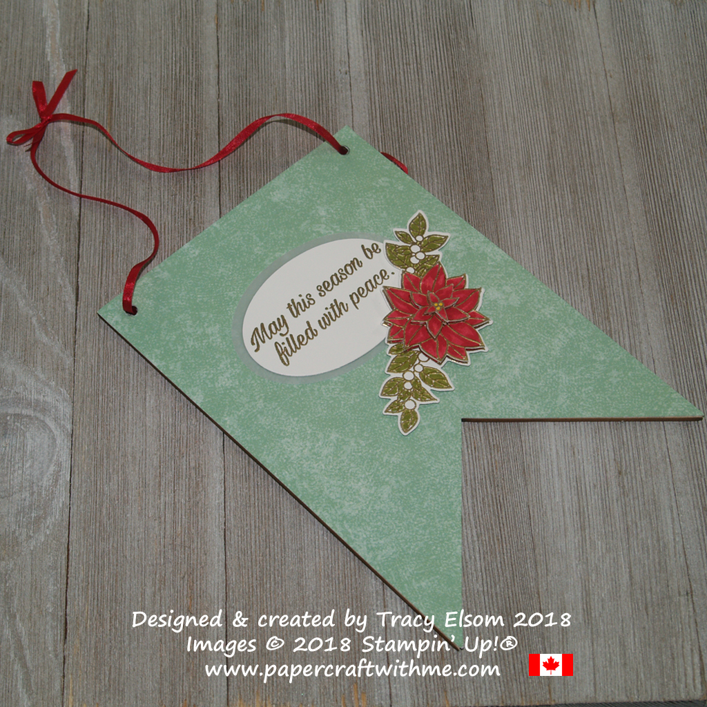 Poinsettia flag decoration created using a wooden base and the Peaceful Poinsettia Stamp Set from Stampin' Up!