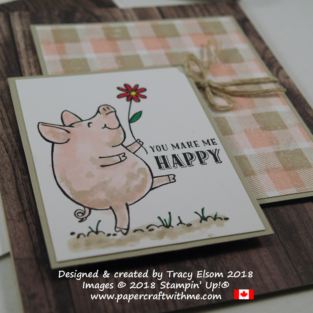 Close up of you make me happy card with a watercoloured image from The This Little Piggy Stamp Set and background panel using the Buffalo Check background Stamp from Stampin' Up!