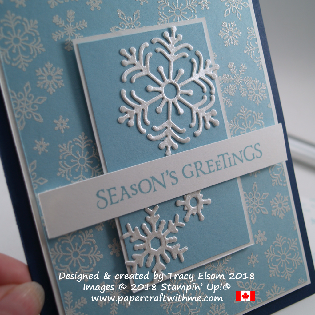 Close up of ' seasons greetings ' card with embossed and die cut snowflakes created using the Beautiful Blizzard Stamp Set and coordinating Blizzard Thinlits Die from Stampin' Up!